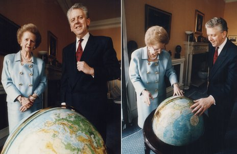 Margaret Thatcher and Charles Powell in front of a globe