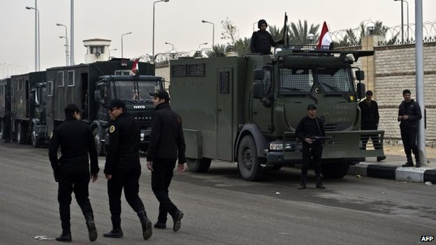 Egyptian riot police are deployed outside the Police Academy where a hearing in the espionage trial of Egypt's ousted Islamist president Mohamed Morsi is to be held in Cairo (16 February 2014)