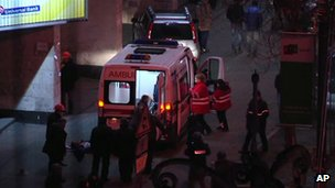 An ambulance arrives to help injured people in central Kiev