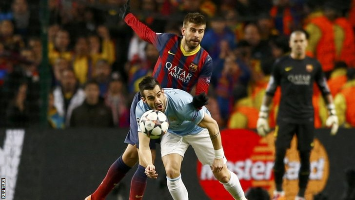 Manchester City's Alvaro Negredo and Barcelona's Gerard Pique