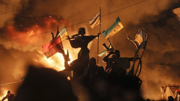 Monuments to Kiev's founders burn as anti-government protesters clash with riot police in Independence Square