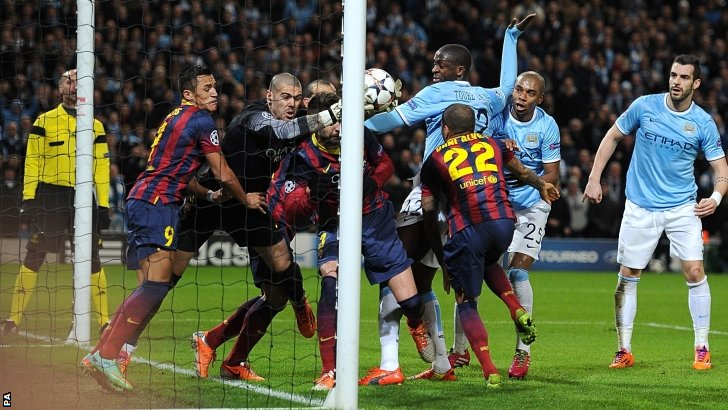A goal-mouth scramble during Man City v Barca