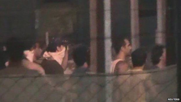 Detainees riot at the Manus Island Detention Centre on 16 February 2014 in this still image taken from ABC footage