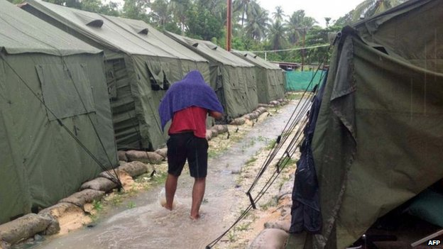 File photo: A man walks between tents at Australia's regional processing centre on Manus Island in Papua New Guinea