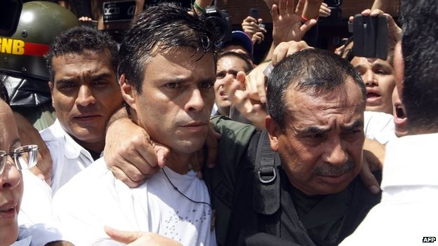 Leopoldo Lopez is escorted by the National Guard after he turned himself in during a demonstration in Caracas on 18 February, 2014