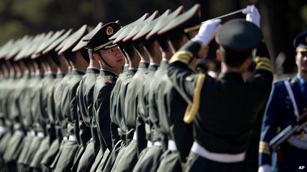 Chinese People's Liberation Army soldiers and officers line up in preparation to welcome visiting Indian Prime Minister Manmohan Singh in Beijing on 23 October 2013