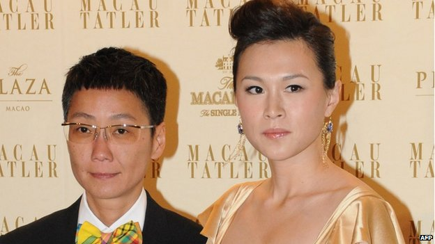 File photo: Gigi Chao (right), the daughter of Hong Kong tycoon Cecil Chao Sze-tsung with her partner, in Macau, 4 September 2011