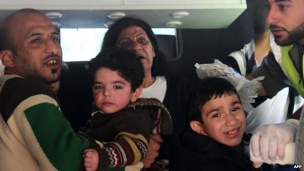 Children from an orphanage located near the bomb blasts in Beirut are taken away by medics (19 February 2014)