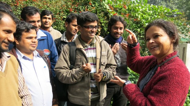 Noida Deaf Society founder Ruma Roka (right) talking to students