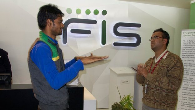 Alok Sagar (left) and Vipin Kumar, both deaf, are the first hearing impaired workers at FIS Global Business Solutions in Gurgaon, a key Indian finance and industrial centre near Delhi
