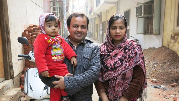Haider Ali with his wife and son outside their home in New Delhi