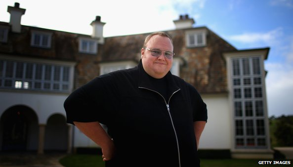 Kim Dotcom outside his mansion