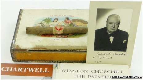 Unsmoked cigar, signed photograph and other items up for auction