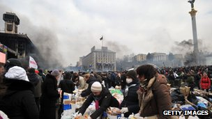 Activists hand out food to anti-government protesters on Independence Square in Kiev.