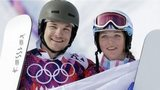 Russia's Vic Wild, left, poses after winning the gold medal in the men's snowboard parallel giant slalom final, with his wife and bronze medalist in the women's snowboard parallel giant slalom final, Russia's Alena Zavarzina