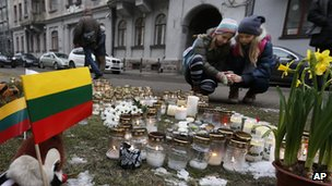 Children light candles in front of the Ukrainian embassy, in Vilnius, Lithuania, 19 February 2014