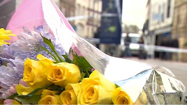 Floral tributes outside Fringe Benefits and La Bella Beauty in Southgate Street, Gloucester