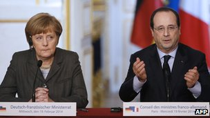 German Chancellor Angela Merkel (L) and French President Francois Hollande give a press conference on 19 February 2014 at the Elysee Palace in Paris