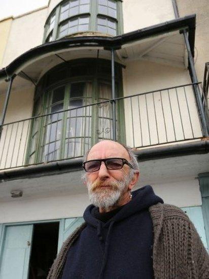 Chris Paraskeva outside his house
