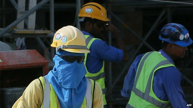 Migrant workers at a construction site in Qatar (3 October 2013)