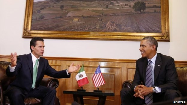 US President Barack Obama (R) attends a bilateral meeting with Mexico's President Enrique Pena Nieto at the El Palacio de Gobierno del Estado de Mexico before the start of the North American Leaders Summit in Toluca, Mexico 19 February 2014