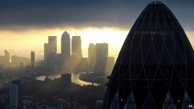 "File photo dated 25/02/10 of the ""Gherkin"" and Canary Wharf at sunrise in the City of London"