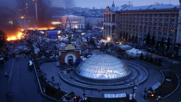 aerial of main square in Kiev with fire and smoke