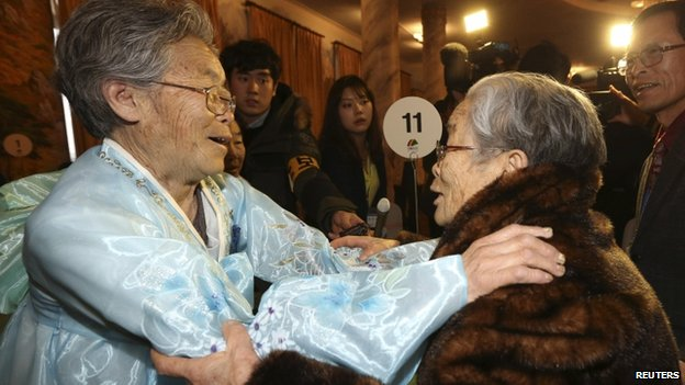 North Korean Kim Seok-ryeo (left), 80, looks at her South Korean sister Kim Sung-yun, 96, during their family reunion at the Mount Kumgang resort in North Korea, 20 February 2014