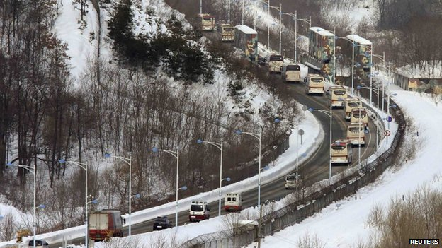 South Korean buses transporting participants of the family reunion events cross the border line as they leave for Mount Kumgang resort in North Korea at Goseong, northeast of Seoul, 20 February 2014