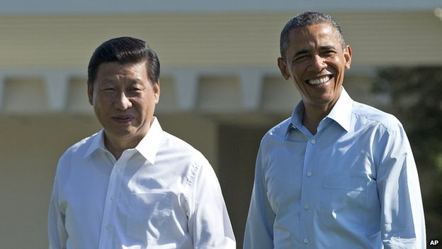 File photo of President Barack Obama and Chinese President Xi Jinping, left, walk at the Annenberg Retreat of the Sunnylands estate in Rancho Mirage, California in 2013