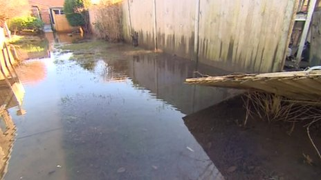 A flooded garden in Diglis Avenue