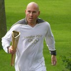 Simon Buckden carrying Olympic torch