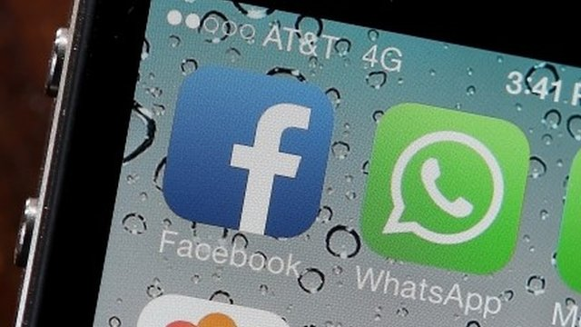 Facebook and WhatsApp icons on a smartphone
