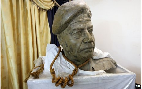 The bust of former Iraqi leader Saddam Hussein and the actual rope used to hang him, on display in the living room of former national security adviser Mowaffak al-Rubaie