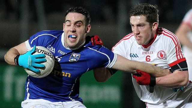Tyrone's Dermot Carlin tackles Cavan's Eugene Keating in Wednesday night's McKenna Cup final at Armagh