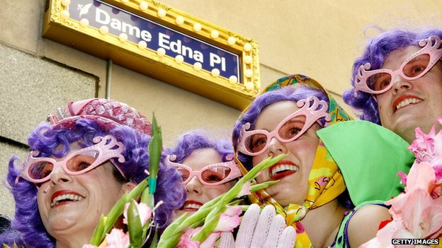 Four Dame Edna Everage look-alikes pose under the street sign as city laneway in Melbourne was being renamed 'Dame Edna Place'
