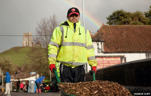 A member of the Ahmadiyya Muslim Youth Organisation from South London wheels wood-chip