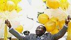 Zimbabwe's President Robert Mugabe holding ballons in 2007