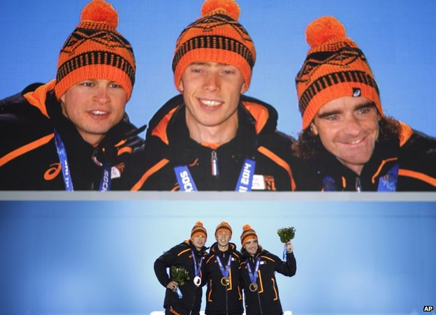 Men's 10,000-meter speed skating medallists, from left, Sven Kramer, silver, Jorrit Bergsma, gold, and Bob de Jong, bronze, all from the Netherlands