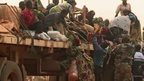 Muslim getting on to a truck, part of  a convoy leaving Bangui to CAR