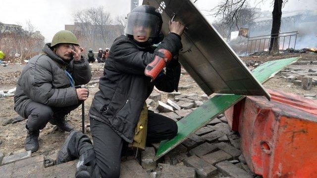 Anti-government protesters take cover