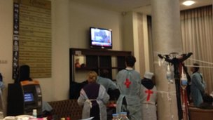 Medics watching TV news in Hotel Ukraine, Kiev (20 Feb)