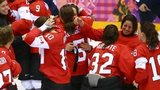Canada celebrates after Marie-Philip Poulin #29 scored the game-winning goal