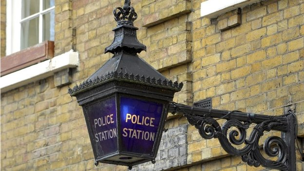 A blue lamp outside the St John's Wood police station, in London