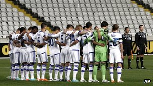 Players of Dynamo Kiev hold a minute's silence before their match with Valencia in Nicosia, Cyprus