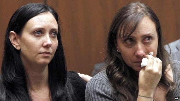 Evin Collins (left) and Bonnie Stow, sisters of beating victim Bryan Stow, in court in Los Angeles on 20 February 2014