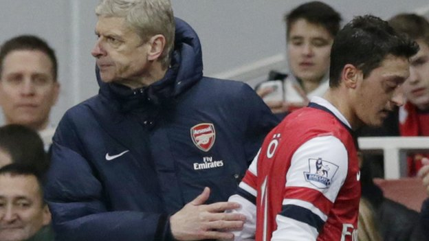 Arsene Wenger and Mesut Ozil of Arsenal