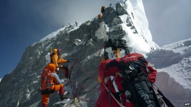 In this May 19, 2009 file photograph, unidentified mountaineers walk past the Hillary Step while pushing for the summit of Mount Everest as they climb the south face from Nepal