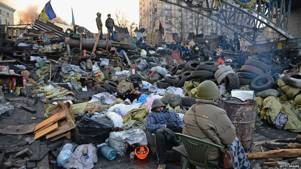 Anti-government protesters man the barricades following Thursday's clashes with police in Independence square
