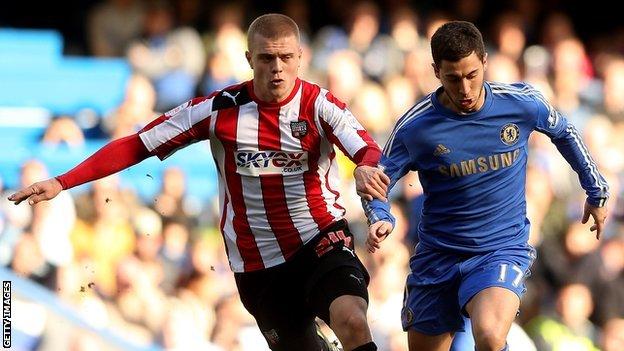 Jake Bidwell challenges Chelsea's Eden Hazard